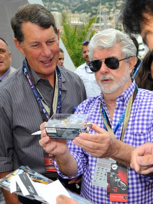 George Lucas (R) onboard the Red Bull Energy Station during the Monaco Formula One Grand Prix at Circuit de Monaco on May 25, 2014 in Monte-Carlo, Monaco.