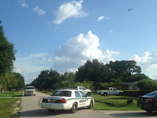 A helicopter (top right) was used to help locate the suspect.