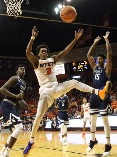 UTEP guard Omega Harris, 2, loses the ball while driving