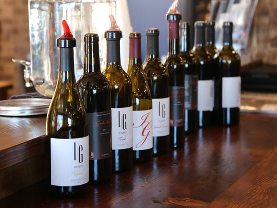 Bottles of wine sit on the counter inside the Iron Gate Winery tasting room.
