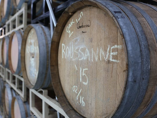 A barrel of Rousanne ages in a neutral oak barrel inside