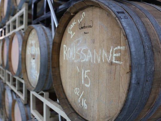 A barrel of Rousanne ages in a neutral oak barrel inside