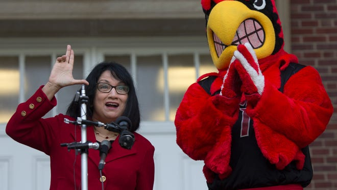 """Incoming University of Louisville President, Dr. Neeli Bendapudi, threw up an """"L"""" on her first day of work. May 15, 2018."""