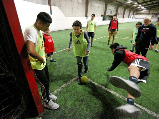 Sierra Bennett scores a goal during a youth soccer program with North Salem High School's boys soccer team, Wednesday, November 18, 2015, at Salem Indoor Soccer Center in Salem, Ore.