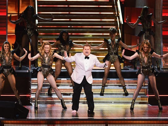 Host James Corden speaks onstage during The 59th GRAMMY