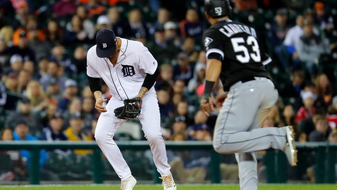 Tigers third baseman Nick Castellanos (9) loses the ball as White Sox leftfielder Melky Cabrera (53) runs to third base on a Avisail Garcia ground ball in the eighth inning of the Tigers' 7-3 loss Friday at Comerica Park.