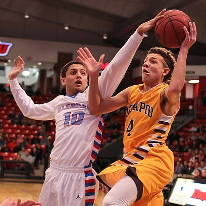 Glendale's George Rosenbury goes in for a layup guarded by Kickapoo's Alex Bernskoetter.