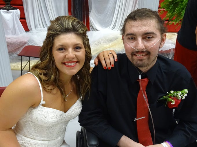 Zach and Kelsie Farmer are pictured at their wedding