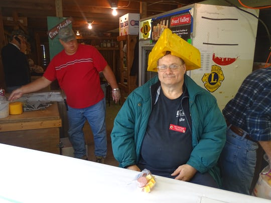 Ray Hootman sells cheese and trail bologna at the West