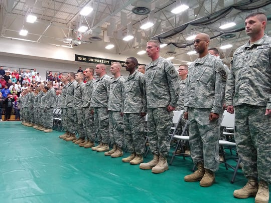 Soldiers stand to be recognized during their Call to Duty ceremony Monday morning. The unit will be deployed to Kuwait           following additional training in Fort Bliss, Texas.