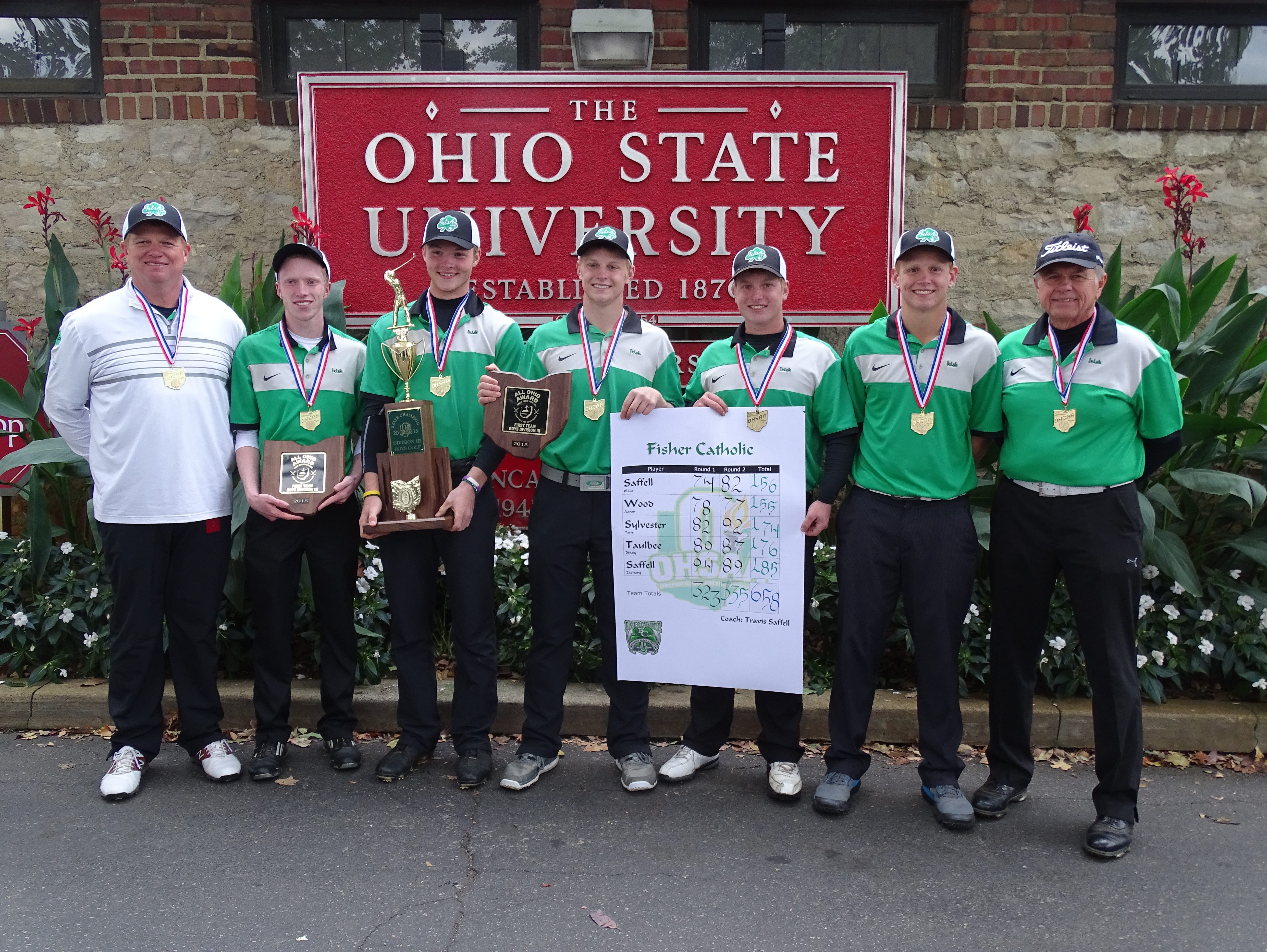 The Fisher Catholic boys golf team won the Division III state championship on Saturday at Ohio State's Scarlet Course. Teams are, from left to right: head coach Travis Saffell, Aaron Wood, Brady Taulbee, Blake Saffell, Tom Sylvester, Zach Saffell and assistant coach Larry Saffell.