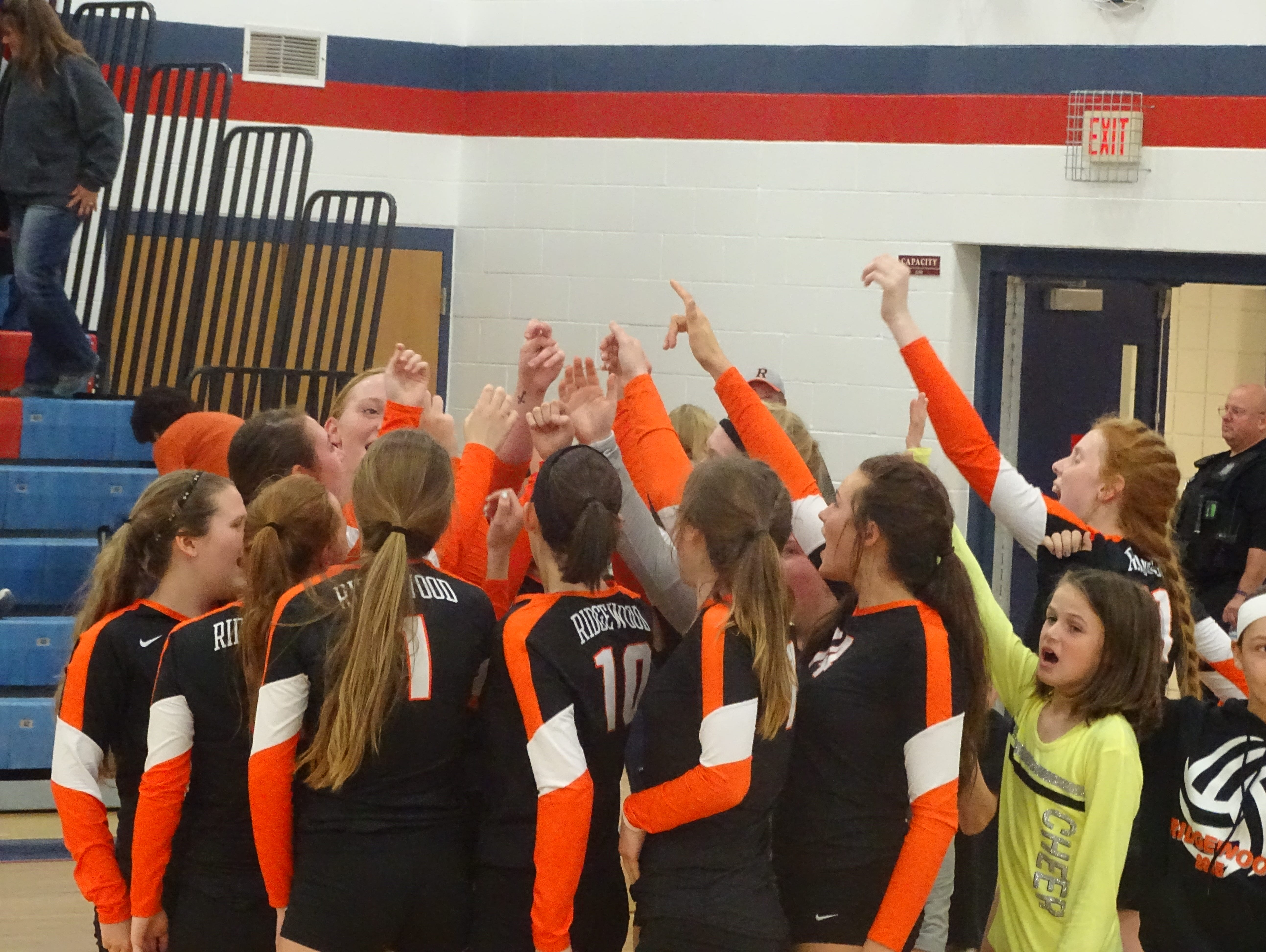 The Generals volleyball team celebrates a 3-1 win over one-seed Buckeye Trail Wednesday.