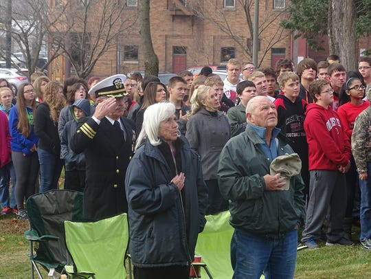 Students, teachers and area residents gathered in front