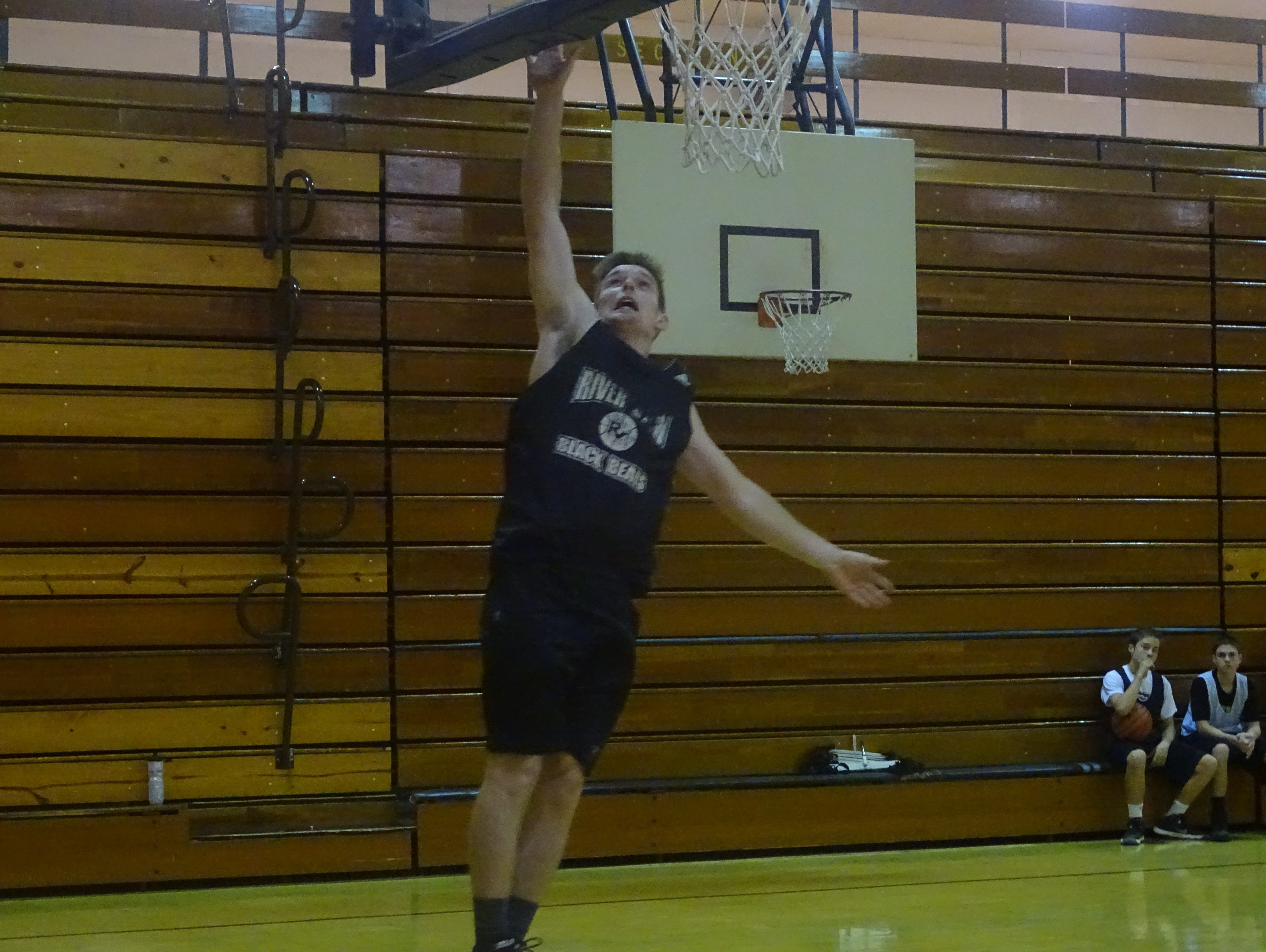 Sophomore Jorn Hocter lays the ball up in practice Wednesday.