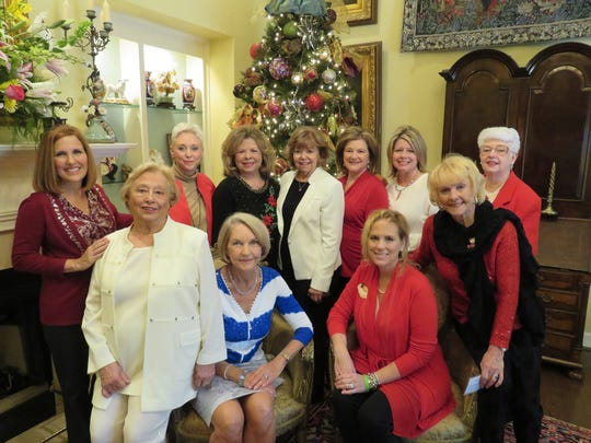 At the Wynlakes Women's Club's Ultimate Christmas Coffee were, front, from left, Vicki Dendis, Jean Wells, Julianna Zell and Christy Fletcher, both seated;  Marlene Cavanaugh-Payne; Rear, from left, Penelope Poitevint, Sharon Thomason, Ann Michaud, Nancy Long, Julie Lankford, Shirley Wesson.