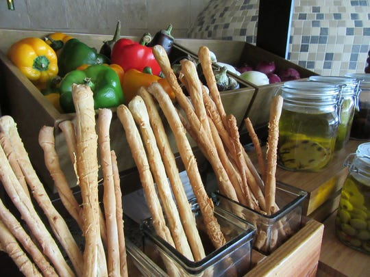 Fresh breadsticks at Italian restaurant Lorenzo's add an authentic touch.