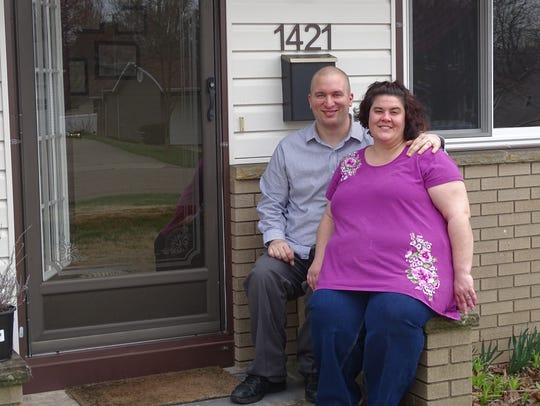 First-time home buyers Jason and Miranda Kodysz sit