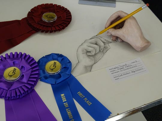 Lydia Dupont, an 11th-grade student at Oak Harbor High School, won Best of Show and People's Choice awards for her multimedia work at the 49th Annual Five County Invitational Art Show.