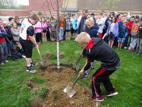 Student Council officers Mitchell Nelson, Keeley Murray and Alec Laaper help plant a linden tree at Coshocton Elementary School in this 2016 Tribune file photo. It was the first year the Coshocton Tree Commission and Coshocton Soil and Conservation District worked with sixth-graders to plant a tree on school property for Arbor Day. The four tree for the program will be planted on April 26.