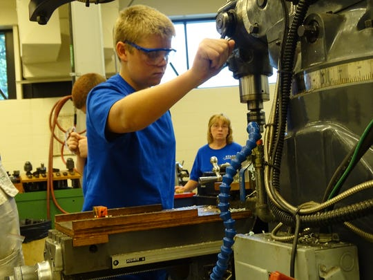 Mason LaRue, 15, of Clay High School operates a manual drill in a machine lab at Terra State as part of the Skilled Trades Apprenticeship Readiness Training (START) program.