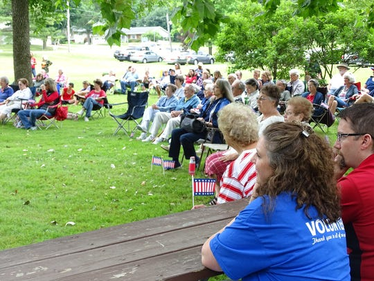 A crowd gathers at Lexington's Bicentennial Park to