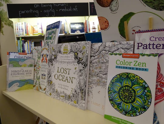 Coloring books with complex designs geared toward adults