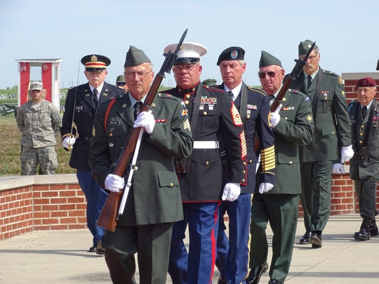 The 555th Honors Detachment color guard marches during the First Shot Ceremony at Camp Perry.