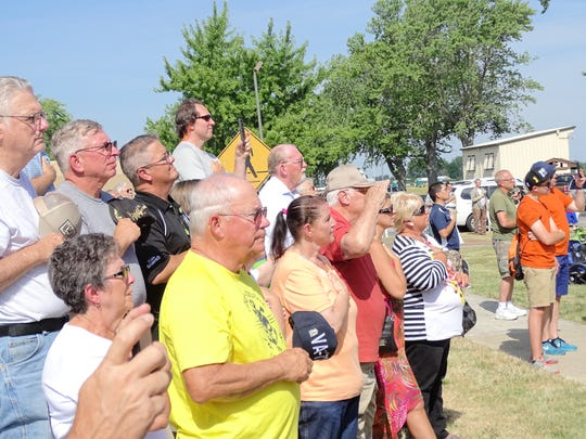 Spectators stand for National Anthem during First Shot Ceremony at Camp Perry.