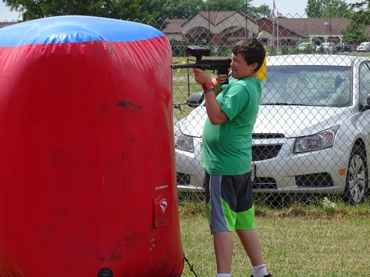Ryan Wendt, 11, of Oak Harbor, takes aim the at the newly released laser tag station set up at the Ottawa County Fair.