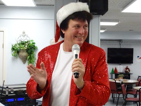 Elvis Presley impersonator Brian Brenner rocks  Fort Stephenson House's 'Christmas in July' party.