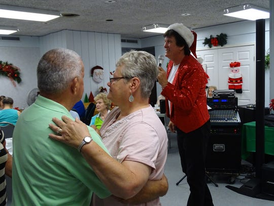 "Dick and Linda Lou Dunfee dance to ""Sixteen Candles,"" sung by Brian Brenner, an Elvis Presley impersonator."