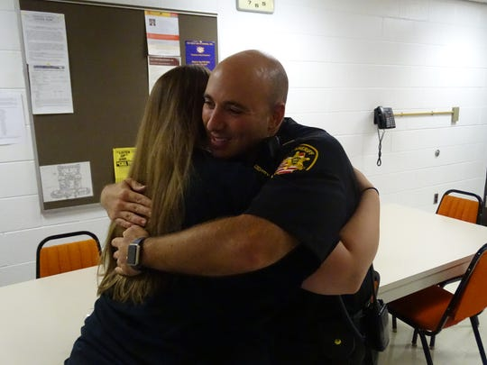 Overcome with joy, Sandusky County Sheriff Capt. Jamison Rose hugs Taylor Wamsley, of Fremont, who delivered sandwiches and fruit to the department Friday as part of Law Enforcement Appreciation week.