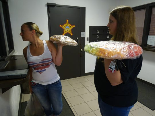 Michelle Ickes, left, and Taylor Wamsely deliver sandwiches and fruit for Sandusky County Sheriff's Office as part of Law Enforcement Appreciation week.