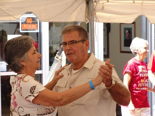 Joe and Jenny Romp of Toledo take to the dance floor at the Perch, Peach, Pierogi & Polka Festival Saturday in Port Clinton.