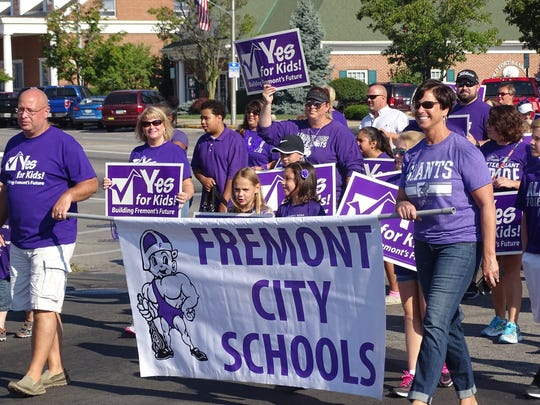 Fremont City Schools Superintendent Traci McCaudy,  right, marches with parents and students Monday at the city's annual Labor Day parade. The parade started at the corner of Front and State streets.