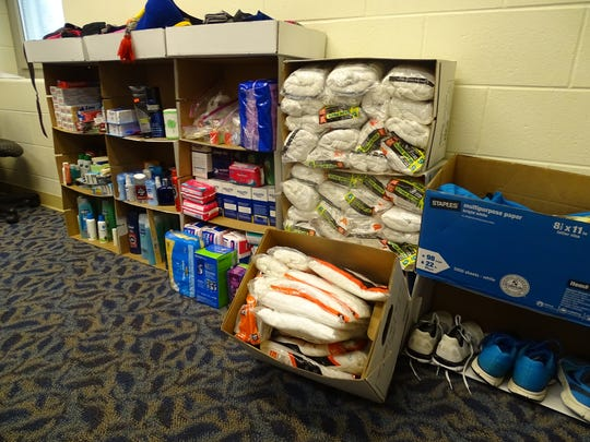 Donations are stacked along the walls of the Adena School store. The items are available for free to students.