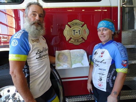 Bob Quick and daughter Jillian Quick show a map of their travels as they ride their bikes across the country.