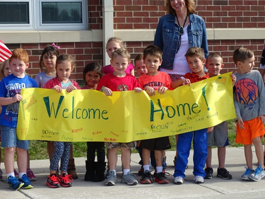 Students at Woodmore Elementary welcome home Tony Unum from Air National Guard service. Unum arrived home Monday from a seven-month deployment in Africa.