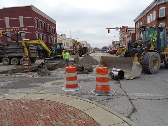 The intersection of Madison and Perry Street is closed in Port Clinton for a water and sewer line separation project. City officials are looking at roads and sewer systems that may need attention after the June 12-13 storm caused significant flooding.