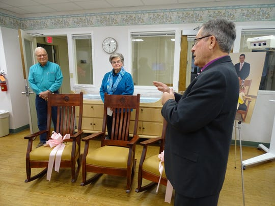 Bob Martin, of Eleonore Rocks, thanks donors Ron House, left, and Martha Lantz, center, for donating rocking chairs to the maternity ward at ProMedica Memorial Hospital in Fremont.