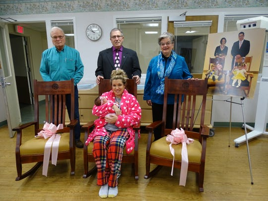 New mother Kristin Balkovec, seated, is surrounded by Eleonore Rocks chair donor Ron House, Eleonore Rocks representative Bob Martin and chair donor Martha Lantz. The three chairs were donated to ProMedica Memorial Hospital so mothers can bond with their newborn babies.