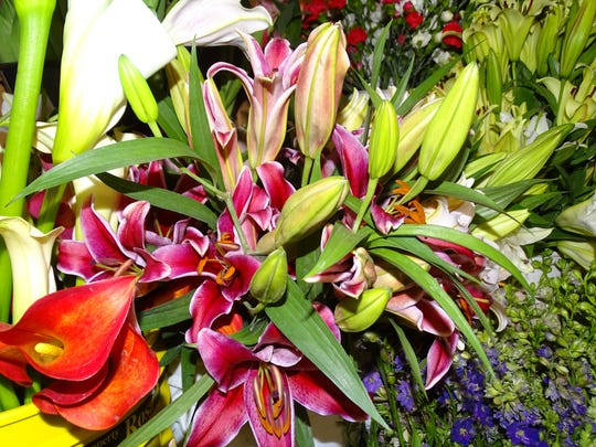 Flowers such as these freshly cut lilies and stargazers are a popular gift for Valentine's Day.