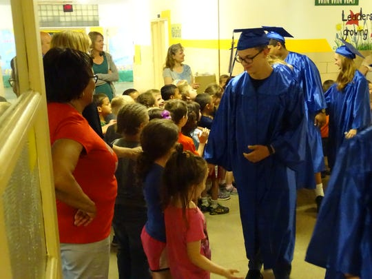 High fives and handshakes were the order of the day Wednesday as the procession of Chillicothe High School graduates walked the halls of Tiffin Elementary as part of Project Graduation.