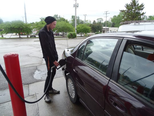 Fremont resident Tyler Johnson fills up his tank at Speedway on East State Street. Johnson said fluctuating gas prices made his travel decisions for him as recent spikes in the $2.50 per gallon range will keep him in the area over the Memorial Day weekend.
