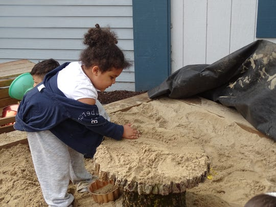 Jianni Martin, 4, plays in one of the sand pits at Stricker Family Development Center.