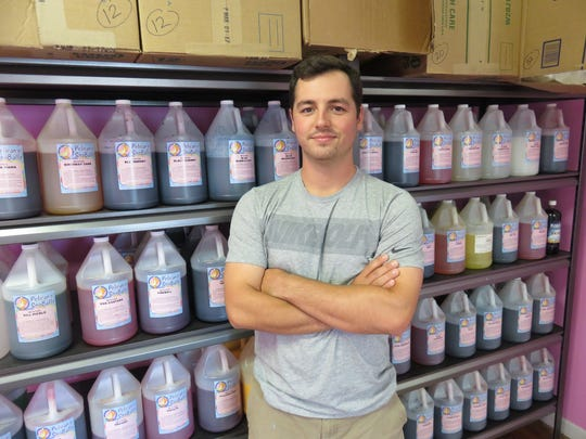 Jeb Scoggins offers over 100 New Orleans-inspired syrups at his new SnoBalls snow cone business.