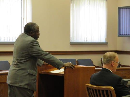 Dwight Burton's defense lawyer Allen Stone, left, delivers an opening statement in Burton's murder trial.