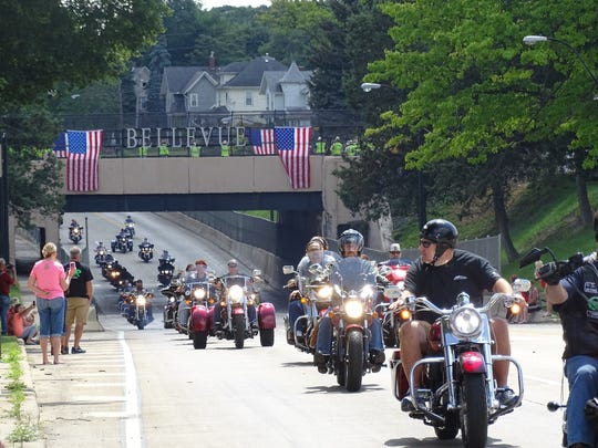 """Hundreds of motorcyclists escort the truck carrying """"The Wall that Heals,"""" a half-sized replica of the Vietnam Memorial Wall in Washington D.C."""