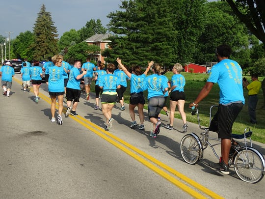 The 2017 Special Olympics Law Enforcement Torch Run travels through Fremont on Thursday with participants from local law enforcement, the Sandusky County Developmental Disabilities and other supporters.