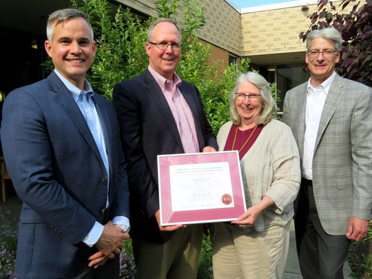 The Corning Children's Center was recently re-accredited by the Middle States Association Commissions on Elementary and Secondary Schools. From left, Michael Donlon, Corning Children's Center board member, Tom McConnell, board vice president, Executive Director Peigi Cook, and board president Kevin Julien.